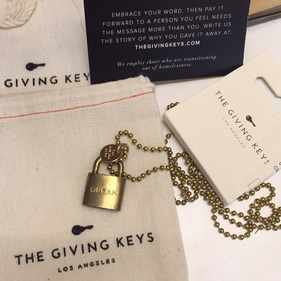 Giving keys brand new with tag and bag necklace Boutique